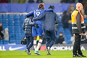 Chelsea forward Tammy Abraham (9) helped off at full time during the Premier League match between Chelsea and Arsenal at Stamford Bridge, London, England on 21 January 2020.