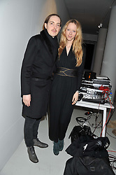 MORWENNA LYTTON COBBOLD and PHILLIP BUSH  at Diego Bivero-Volpe's 30th birthday party in aid of the charity Kids Company held at the Rook & Raven Gallery, 7 Rathbone Place, London W1 on 12th April 2013.