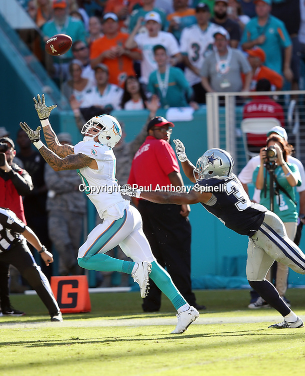 Miami Dolphins wide receiver Kenny Stills (10) is covered by Dallas Cowboys free safety Byron Jones (31) as he catches a 29 yard touchdown pass that ties the third quarter score at 14-14 during the 2015 week 11 regular season NFL football game against the Dallas Cowboys on Sunday, Nov. 22, 2015 in Miami Gardens, Fla. The Cowboys won the game 24-14. (©Paul Anthony Spinelli)