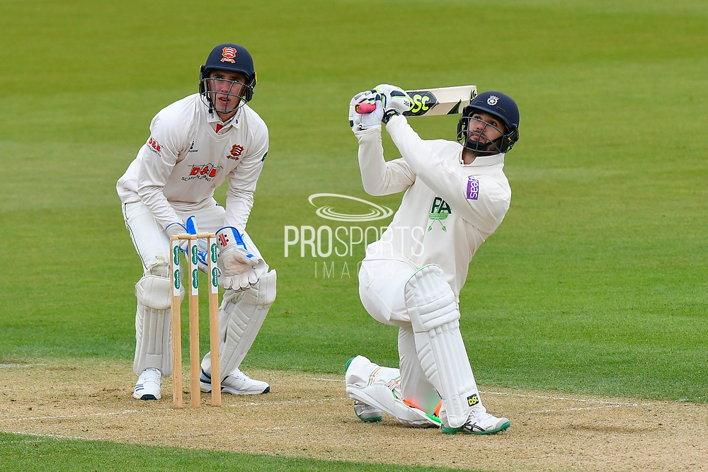 Rilee Rossouw of Hampshire hits the ball over the boundary for six runs during the first day of the Specsavers County Champ Div 1 match between Hampshire County Cricket Club and Essex County Cricket Club at the Ageas Bowl, Southampton, United Kingdom on 5 April 2019.