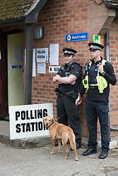 © Licensed to London News Pictures. 08/06/2017. Sonning, UK. Police guard Prime Minister Theresa May's local polling station before she arrives to cast her vote. Polling stations are open from 7am - 10pm.  Photo credit: Peter Macdiarmid/LNP