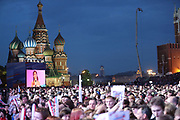 MOSCOW, RUSSIA - JUNE 12:  People watch performers on stage in Red Square during a concert to celebrate 'Russia Day' ahead of the 2018 World Cup on June 12, 2018 in Moscow, Russia. Since 1992 'Russia Day' has been celebrated on June 12 as the Russian Federation's national holiday. , fee liable image, copyright © ATP Amin JAMALI<br /> IMPRESSIONS MOSCOW 2018 - People - City - FANS,  <br /> Football World Cup starts in MOSCOW on June 14th 2018<br /> Honorarpflichtiges Foto, Fee liable image, Copyright © ATP Amin JAMALI