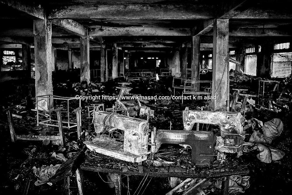 Several burnt sewing machines are in the first floor of the Garib & Garib sweater factory after a fire in Gazipur 26 February 2010. Twenty-one garment workers were killed and some 50 injured in the fire started on the first floor of the seven-storey building as workers had finished for the night and were leaving the factory while lack of safety standards and poor wiring cause several fatal factory fires every year in Bangladesh.