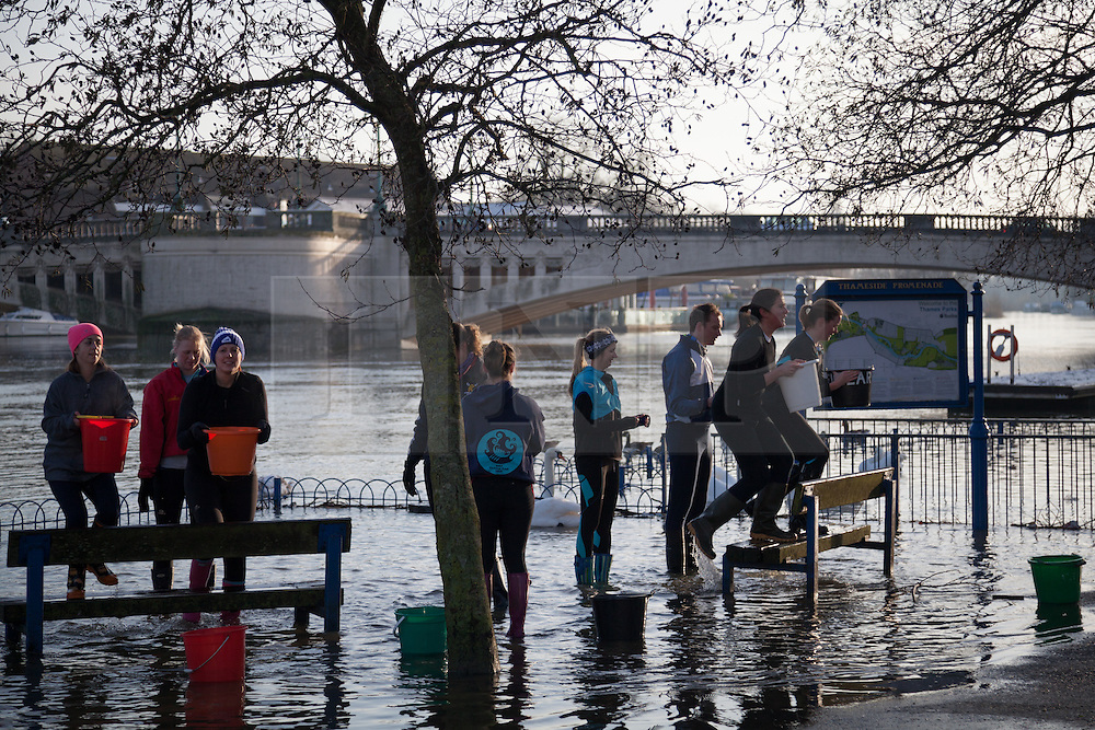 © Licensed to London News Pictures. 12/01/2014. Reading, Berkshire, UK. Members of Reading Rowing Club training along the Thames Path in Reading, Berkshire. The River Thames has broken its banks causing extensive flooding. Photo credit : Rob Arnold/LNP
