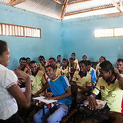 "BA Futuru means ""for the sake of the future"" in Tetun, the national language in Timor Leste. BA Futuru grew out of the fightings in 2006 where civil unrest and infighting between police and army caused massive damages and thousands of killed. BA Futuru wants to prevent future conflicts through training children, youths and authorities like staff at schools and police in conflict resolution. This class high school students have been through 4 days of conflict resolution workshop run by Ba Futuro. Raul is explaining how it has changed their every day at school, they no longer fear their teachers and they can now manage their own conflicts better, also at home in the community. Judith Maria de Sousa, trainer."