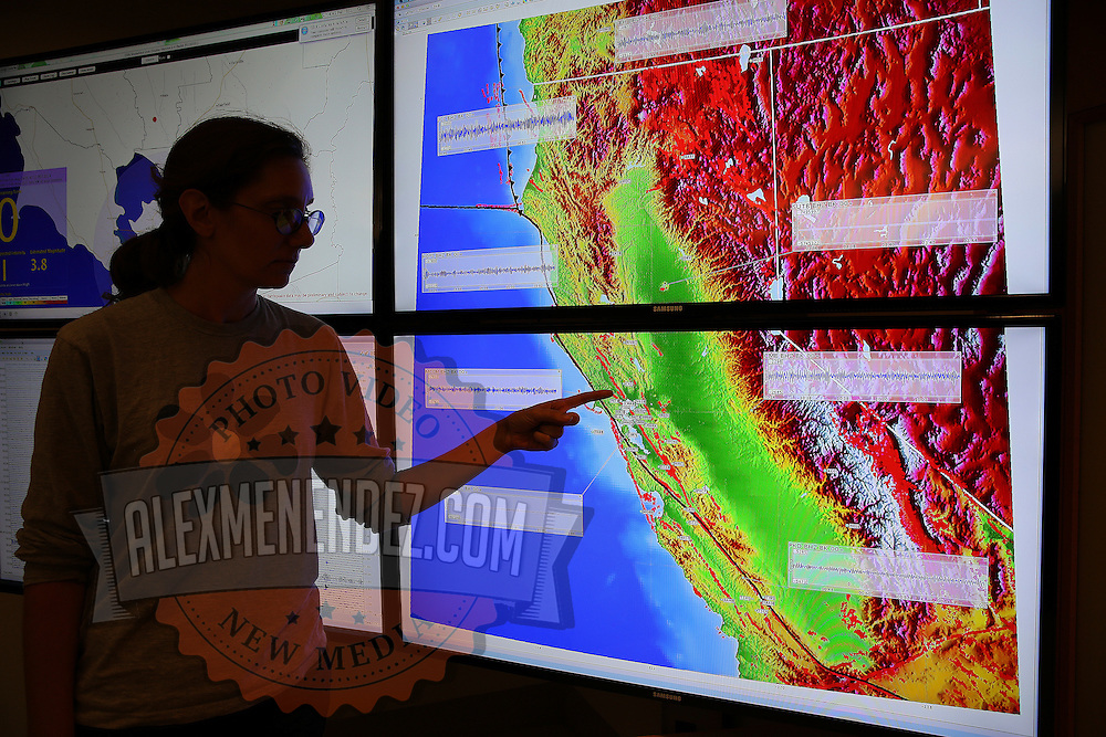 Research seismologist Ingrid Johnason, from the Berkeley Seismological Lab, shows the seismogram of the Napa earthquake on a big screen monitor, as seen from a recording station located in Berkeley, California, on Sunday, August 24, 2014. The 6.1 magnitude earthquake caused significant damage and left three critically injured in California's northern Bay Area early Sunday, igniting fires, sending at least 87 people to a hospital, knocking out power to tens of thousands and sending residents running out of their homes in the darkness. Aftershocks are still being captured across the area by the data stations that are recording seismic data.(AP Photo/Alex Menendez)