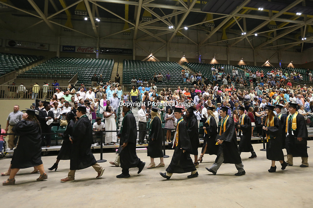 Mooreville High School graduates walk out of the arena after Mooreville's graduation ceremony Saturday afternoon at the BancorpSouth Arena.