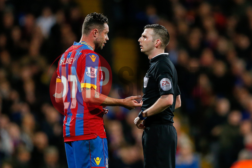 Damien Delaney of Crystal Palace is spoken to by referee Michael Oliver - Photo mandatory by-line: Rogan Thomson/JMP - 07966 386802 - 06/04/2015 - SPORT - FOOTBALL - London, England - Selhurst Park - Crystal Palace v Manchester City - Barclays Premier League.