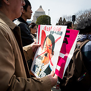 "TOKYO, JAPAN - MARCH 5 : Anti-Abe protester holding a placard reading ""GET OUT! IDIOT PM ABE, BRING BACK OUR PREVIOUS JAPAN! gather in front of the National Diet Building to protest against the policies of Shinzo Abe and to call on the Japanese prime minister to resign, Tokyo, Japan, March 5, 2017. Japan's ruling party approved a change in party rules Sunday, after an annual convention of lawmakers and members of his ruling Liberal Democratic Party (LDP) that could pave the way for Prime Minister Shinzo Abe to become the country's longest-serving leader in the post-World War II era. (Photo: Richard Atrero de Guzman/NUR Photo)"