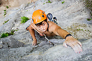 Jesse Degani's eyes bulge as he reaches for a hold on Charlie Don't Surf, 5.10d.<br /> Austin, Texas