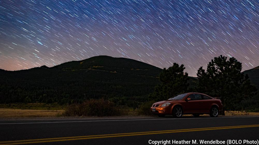 BOLO Photo<br /> Wild West Automotive Photography<br /> Roadside Reflection on Star Trail Solitude <br /> 18 Sep 18<br /> Sheep Lake, Rocky Mountain National Park, Colorado <br /> (2007 Pontiac G5 GT: Heather Wendelboe)