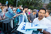 "New York, NY – 16 September 2019. Massachusetts Senator and Democratic Presidential candidate Elizabeth Warren drew a large and enthusiastic crowd at a speech for her increasingly popular 2020 presidential campaign in New York's Washington Square. Volunteers handed out ""I'm a Warren Democrat"" signs prior to her appearance."
