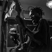 Thula is performing with his punk rock band, TCIYF, during a concert at a bar in Linden, an upmarket suburb in Johannesburg. TCYIF was created five years ago in Soweto but gained a diverse and significant audience beyond the township. April 2017, Johannesburg. © Miora Rajaonary / Native Agency