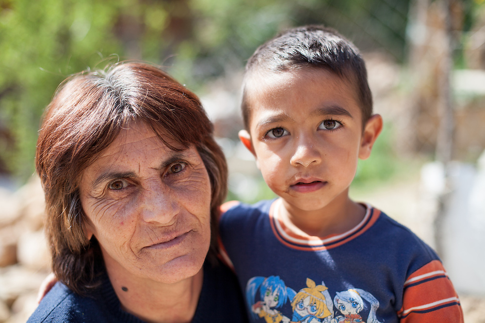 A woman living in the Roma part of the city of Crnik is getting a photograph with her grandchild.