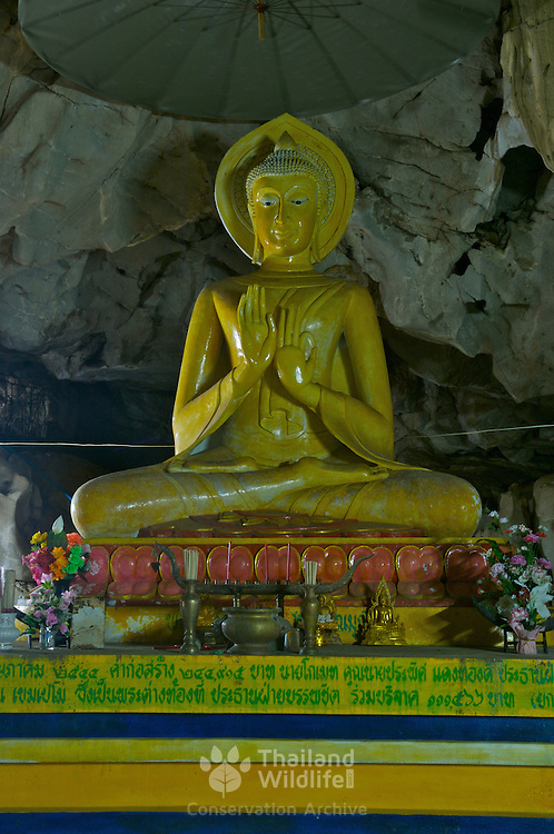Buddha statue inside the Wat Khao Pin Thon cave in Ratchaburi, Thailand