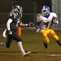 Lauren Wood | Buy at photos.djournal.com<br /> Booneville's Dallas Gamble makes a carry past Kossuth's Dusty Roberts during Friday night's game at Kossuth.