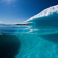 Greenland, Ilulissat, Underwater view of melting iceberg from Jakobshavn Glacier floating in Disko Bay on sunny summer morning
