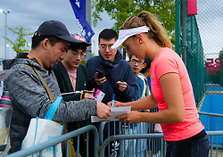 September 30, 2018 - Elise Mertens of Belgium signs autographs at the 2018 China Open WTA Premier Mandatory tennis tournament (Credit Image: © AFP7 via ZUMA Wire)
