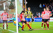 Exeter City's Robert Olejnik despirate dive is unable to keep the ball from grossing the line for a Dagenham goal during the Sky Bet League 2 match between Exeter City and Dagenham and Redbridge at St James' Park, Exeter, England on 2 January 2016. Photo by Graham Hunt.