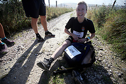 UK ENGLAND 29JUL17 - A team member who fell on her way to checkpoint 2 at Hilltop Farm rests on the ground during the Trailwalker 2017 challenge across the South Downs National Park, England.<br /> <br /> jre/Photo by Jiri Rezac<br /> <br /> &copy; Jiri Rezac 2017