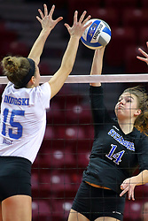 23 November 2017:  Cassie Kawa strikes towards blocker Nikkie White during a college women's volleyball match between the Drake Bulldogs and the Indiana State Sycamores in the Missouri Valley Conference Tournament at Redbird Arena in Normal IL (Photo by Alan Look)