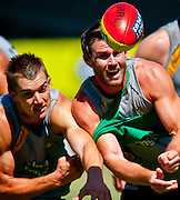 Players of the Richmond Tigers of the Australian Football League at a summer workout in Melbourne, Victoria, Australia.