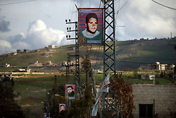 Photographs of Hezbollah martyrs line the streets of Bint Jbeil, Lebanon, March 10, 2005. Earlier in the week hundreds of thousands of pro-Syrian protesters answered the nationwide call from Hezbollah, the militant Shiite Muslim group, to demonstrate against foreign intervention.