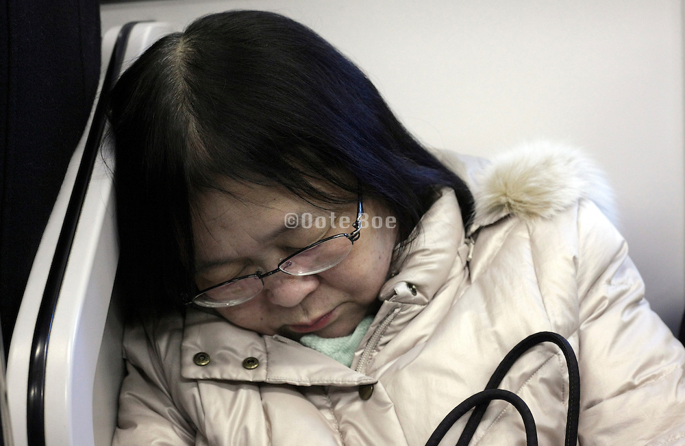 portrait of Asian woman during a commuting nap