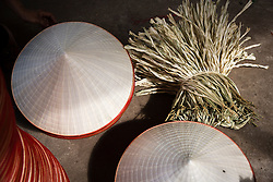 "Stacks of conical hats in Chuong Village, Ha Tay Province, Vietnam, Southeast Asia, 2013. This handicraft village specializes in the fabrication of the conical hat, known as ""non"" in Vietnamese."