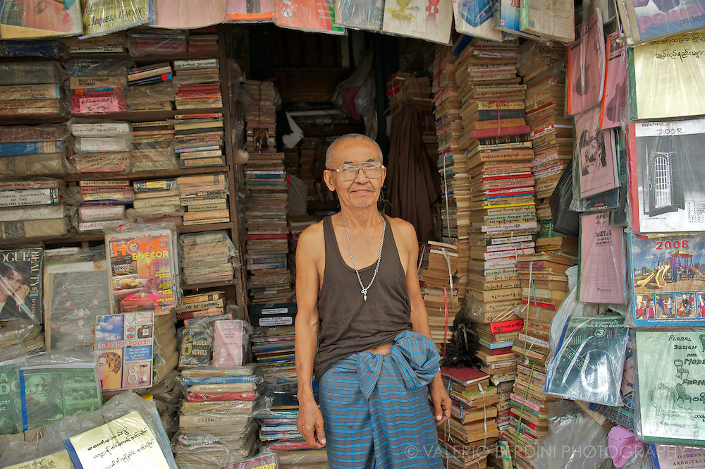 A bookseller in Rangoon. For years the regime banned most western books and tore from magazines the pages of articles considered inappropriate.