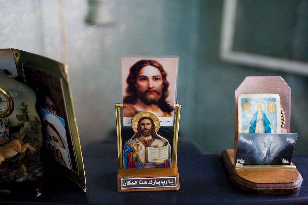 A catholic religious symbol in the house of an Iraq refugee, prostitute, living in Damascus,Syria. With no permission to work many iraqi refugees turn to prostitution to find a way of living.(full text upon request).