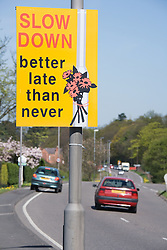 Road sign encouraging motorists to slow down,