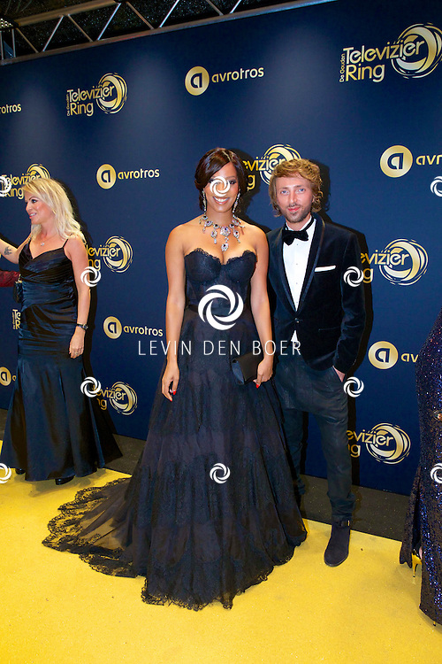 AMSTERDAM - In Theater Carré is de Gouden Televizier-Ring Gala 2014 gehouden. Velen bekende Nederlanders kwamen over de gouden loper. Met hier op de foto  Carolina Dijkhuizen en styling Tommy Driessen. FOTO LEVIN DEN BOER - PERSFOTO.NU