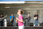 Revelers dance as Fast Lane Band performs during the Milpitas Summer Concert Series at Murphy Park in Milpitas, California, on July 14, 2015. (Stan Olszewski/SOSKIphoto)