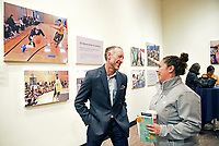 Larry Imwalle, executive director of the Action Council of Monterey County, and Fernanda Ocaña, of the community safety division of the City of Salinas, at the December 5th, 2017 opening of the Stories from Salinas exhibition at the CSUMB Salinas Center for Arts and Culture in Oldtown. The exhibition celebrates the mentors, youth and families of the Salinas Youth Initiative.