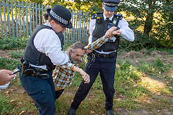 © Licensed to London News Pictures. 14/09/2019. London, UK. Roger Hallam from protest group Heathrow Pause is arrested while setting up a toy drone in Stanwell inside London Heathrow airport's exclusion zone. Mr Hallam was also arrested on Thursday this week by police attempting to stop the group's anti-Heathrow drone protest. Photo credit: Peter Manning/LNP