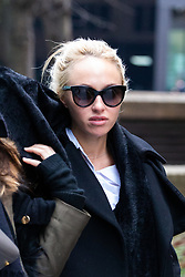 Stephanie Scolaro, 26, leaves Southwark Crown Court In London where she is facing charges of smuggling python skin products into the UK. London, December 14 2018.