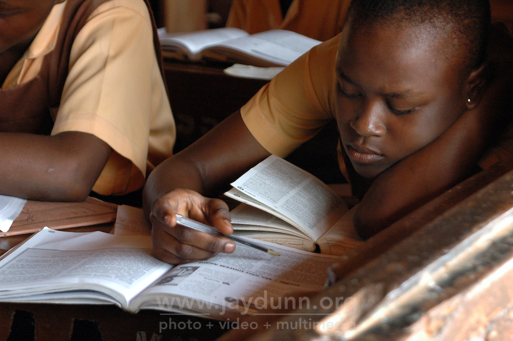 Ghana, Accra, Kokomlemle, 2007. The excitement from the Independence Day assembly wanes as students prepare for the weekly test. .