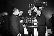 05/04/1966<br /> 04/05/1966<br /> 05 April 1966<br /> Presentation Awards for entries in the N.A.I.D.A. Parade at the Shelbourne Hotel, Dublin. Photo shows (l-r): Mr. L.V. Nolan, President of the N.A.I.D.A. with the winners of the major awards, Mr. W.J. O'Toole, Sales Promotion, W. & R. Jacob and Co., Ltd. (2nd prize Arklow Pottery Perpetual Award); Mr. Aidan Creedon, Managing Drector, Gypsum Industries Ltd., (1st prize Coras Iopmair Eireann Premier Award) and Mr. Tim Dennehy, Information Officer, C.I.E., (3rd prize Jewellery and Metal Company Perpetual Award).