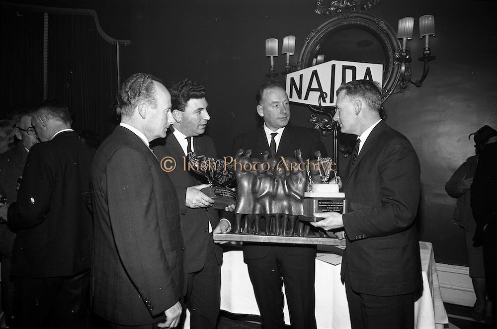 05/04/1966<br /> 04/05/1966<br /> 05 April 1966<br /> Presentation Awards for entries in the N.A.I.D.A. Parade at the Shelbourne Hotel, Dublin. Photo shows (l-r): Mr. L.V. Nolan, President of the N.A.I.D.A. with the winners of the major awards, Mr. W.J. O'Toole, Sales Promotion, W. &amp; R. Jacob and Co., Ltd. (2nd prize Arklow Pottery Perpetual Award); Mr. Aidan Creedon, Managing Drector, Gypsum Industries Ltd., (1st prize Coras Iopmair Eireann Premier Award) and Mr. Tim Dennehy, Information Officer, C.I.E., (3rd prize Jewellery and Metal Company Perpetual Award).
