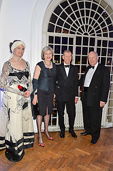 Left to right, LADY FELLOWES, the Home Secretary THERESA MAY, PHILIP MAY and LORD FELLOWES at the Sugarplum Dinner in aid Sugarplum Children a charity supporting children with type 1 diabetes and raising funds for JDRF, the world's leading type 1 diabetes research charity held at One Marylebone, London on 18th November 2015.