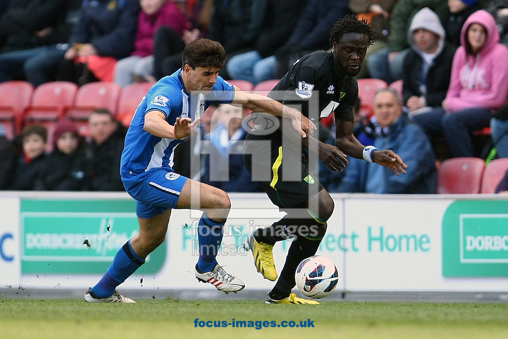 Picture by Paul Chesterton/Focus Images Ltd +44 7904 640267.30/03/2013.Kei Kamara of Norwich and Paul Scharner of Wigan in action during the Barclays Premier League match at the DW Stadium, Wigan.
