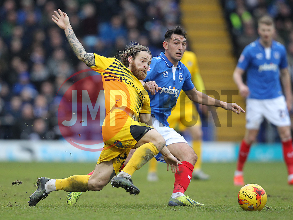Stuart Sinclair of Bristol Rovers is challenged by Gary Roberts of Portsmouth - Mandatory byline: Paul Terry/JMP - 13/02/2016 - FOOTBALL - Fratton Park - Portsmouth, England - Portsmouth v Bristol Rovers - Sky Bet League Two