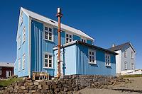 í Flatey, húsin Vogur og Ásgarður. Blár himinn..Flatey island, houses Vogur and Asgardur, blue sky.