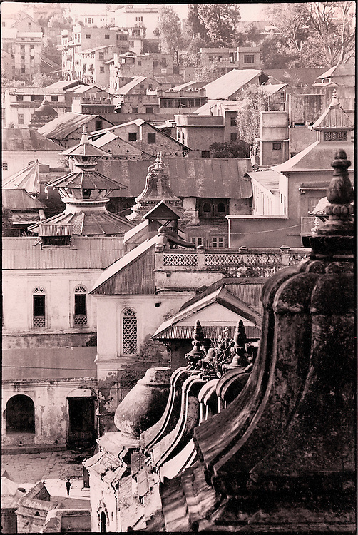 A sepia toned, black and white image of the pagodas and rooftops of the Hindu Pashupatinath temple and town complex devoted to Lord Shiva in Nepal's Kathmandu Valley