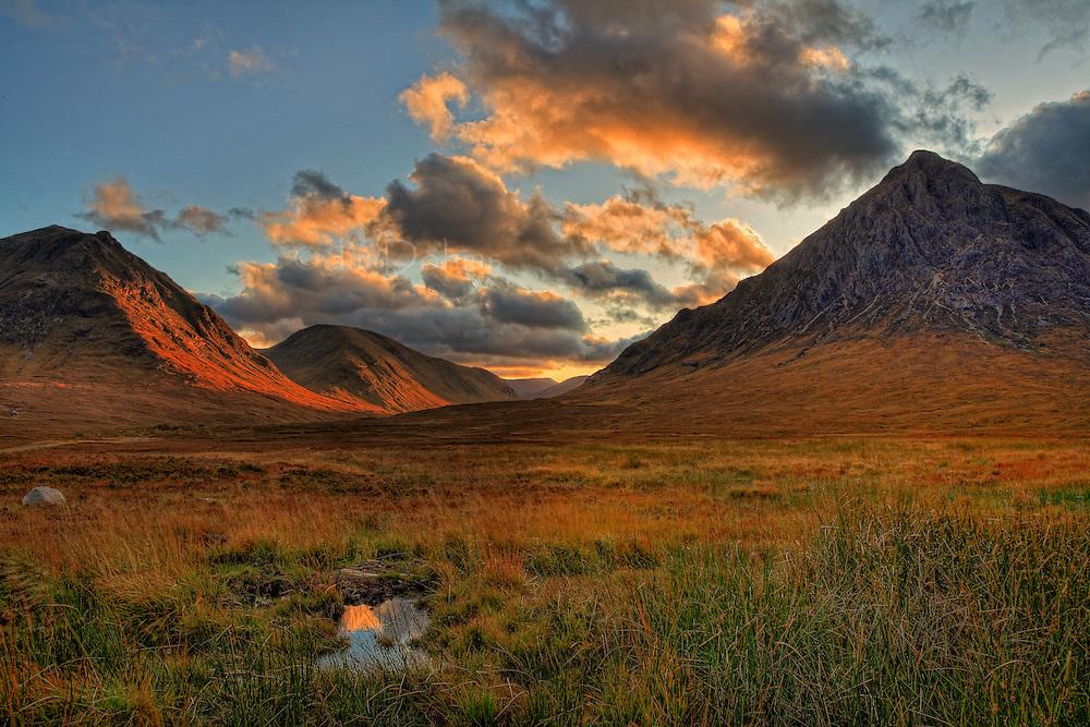 Glencoe in October as the evening sun illuminates the mountains.