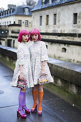 March 4, 2018 - Paris, France - Asian twins Amiaya with pink hair wearing white dress seen outside Valentino during Paris Fashion Week Womenswear Fall/Winter 2018/2019 on March 4, 2018 in Paris, France. (Credit Image: © Nataliya Petrova/NurPhoto via ZUMA Press)