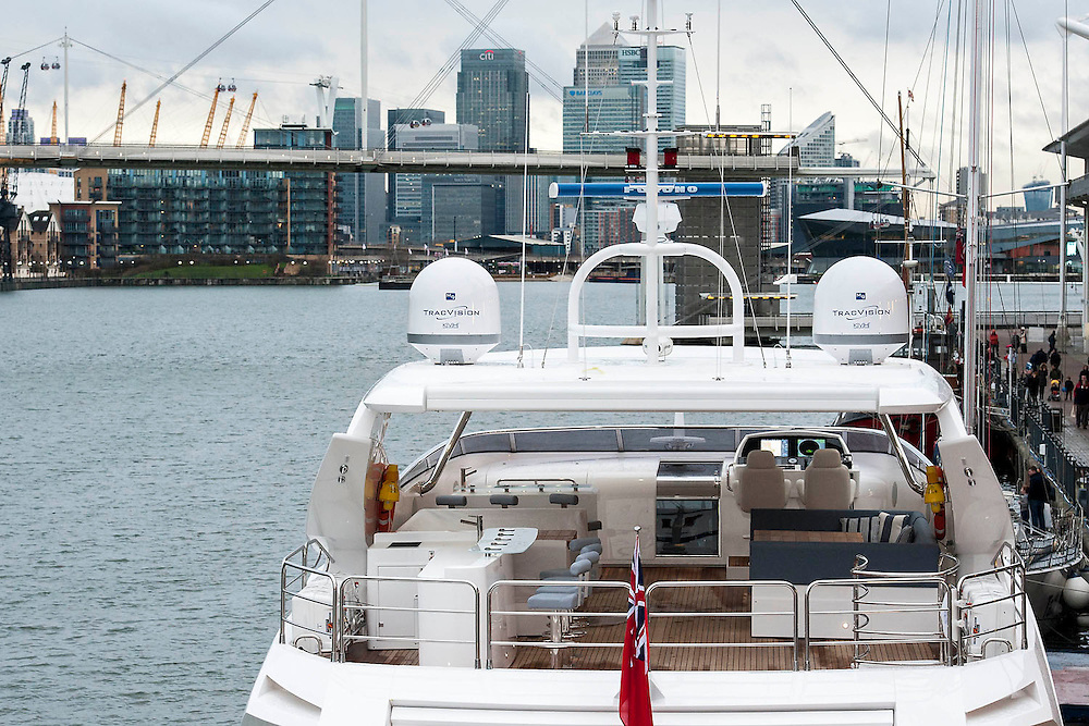 The Sunseeker 115 (feet - and £11m approx) is moored in the Royal Victoria Dock with a view of Canary Wharf. The London Boat Show opens at the Excel Centre, Docklands, London, UK 04 January 2014. Guy Bell, 07771 786236, guy@gbphotos.com