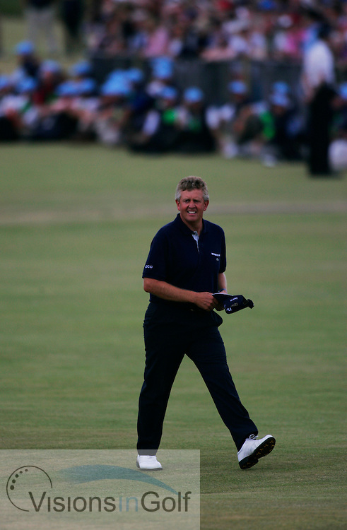 Colin Montgomerie walks down the 18th fairway<br />