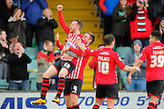 Exeter City's Jake Taylor is held aloft by Exeter City's Jayden Stockley after scoring the visitors second goal to make the score 2-0 during the Sky Bet League 2 match between Yeovil Town and Exeter City at Huish Park, Yeovil, England on 9 April 2016. Photo by Graham Hunt.